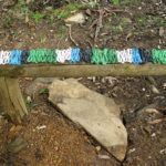 Coils of telephone wire in white, blue, black, light metallic green and dark metallic green, on a bench at Billy Goat Falls, Kangaroo Island.
