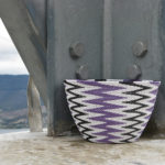 A close-up of the finished chevron-patterned basket placed on top of a concrete pylon on Mt Direction, near Hobart.