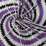 The base of a telephone wire basket in progress. Nearing completion with just a few strands left.